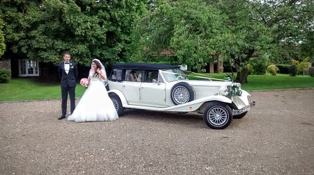 Bride and Groom with their Wedding car at Tickton Grange, East Yorkshire